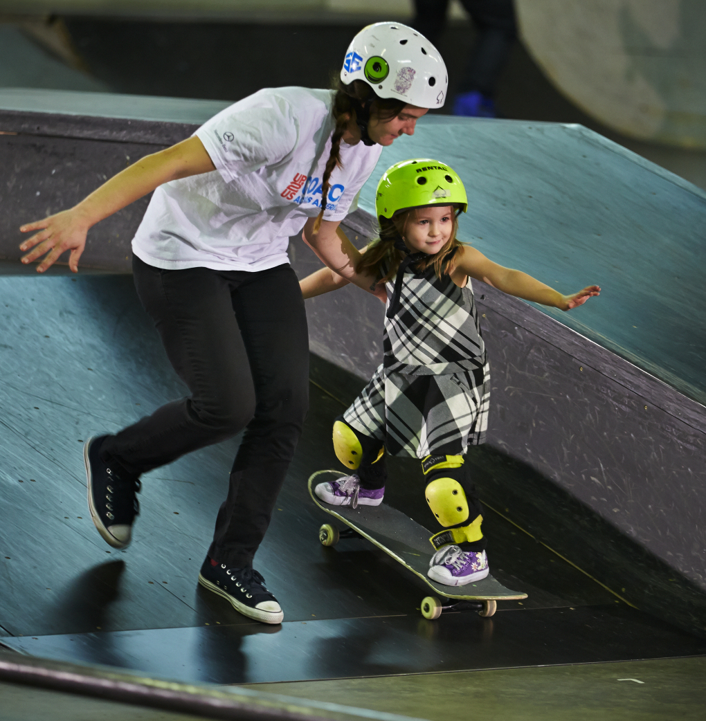 Pacific Northwest Magazine. Fitness story. Skateboard instructor Kristin Ebeling assists 4-year-old Frankie Gonzales during a skateboard class at the indoor All Together Skatepark in Wallingford.